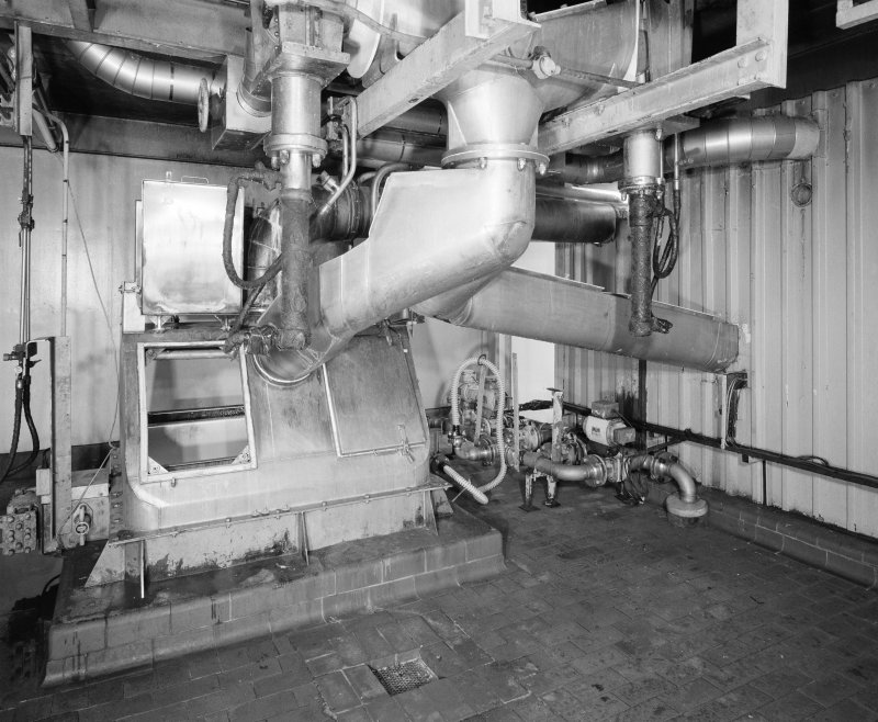 View of two PETN Nitrators, feeding diverter, from which pipes lead either to the Nitration Filter or (right), to the drowning tank if there is a problem withthe batch