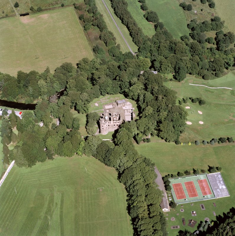 Oblique aerial view of Huntly Castle from SSW.