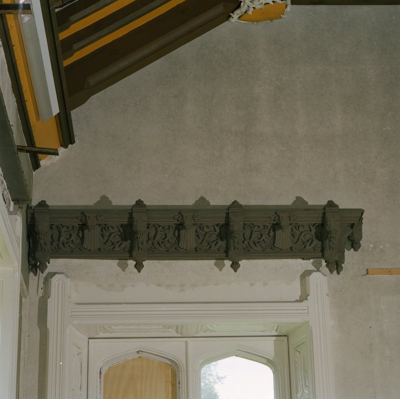 Interior. Ground floor, dining room, detail of carved wooden pelmet