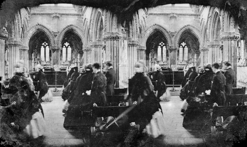 Stereoview of the interior of Roslin Chapel during service.