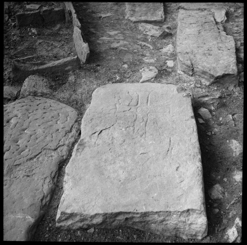 Excavation photograph, detail of incised cross-slab.