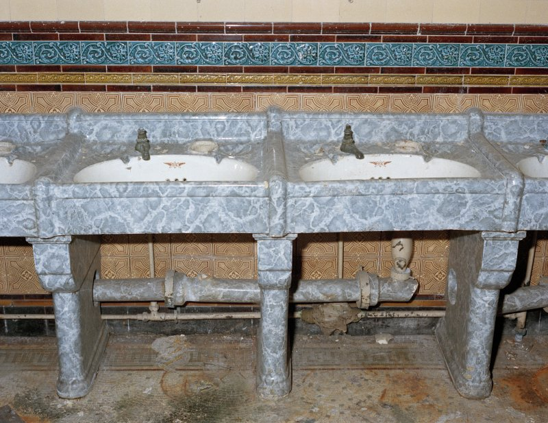 View of sinks (two of four), with grey 'marble' surround, created by a glaze on a clay base.   Photosurvey 9-OCT-1991