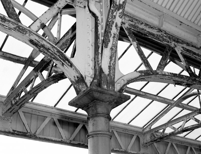 Detail of cast-iron column head and canopy steelwork.