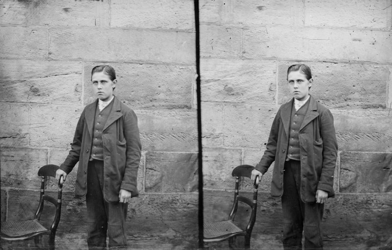 Stereoview of a boy, possibly in front of Roslin Chapel.