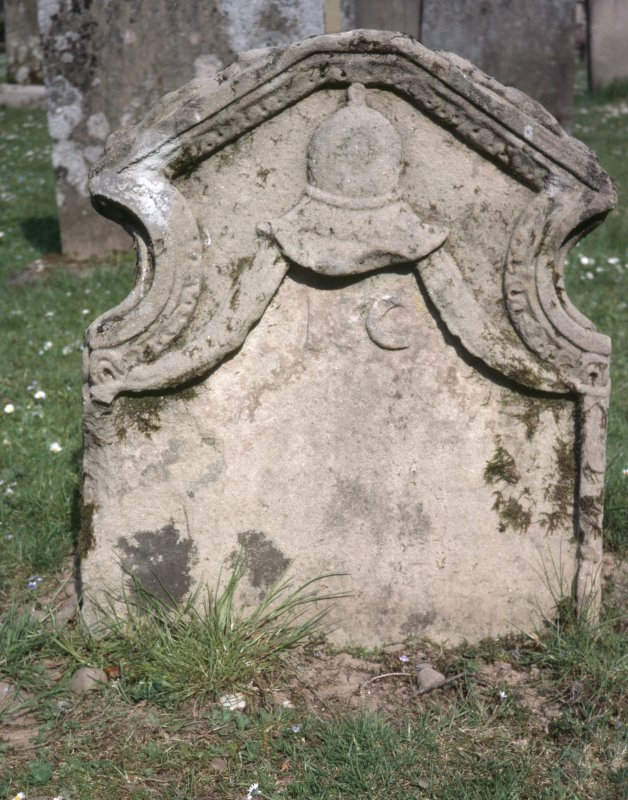 View of headstone showing helmet and dated 1735,  Longformacus Churchyard.