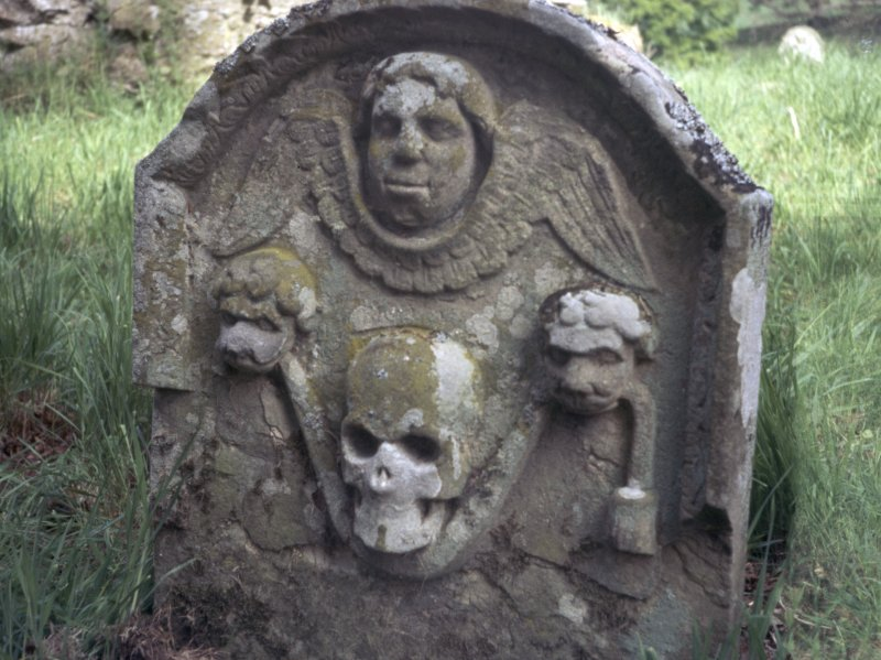 Detail of headstone showing winged angel and skull carried by two lions, Crailing Old Burial Ground