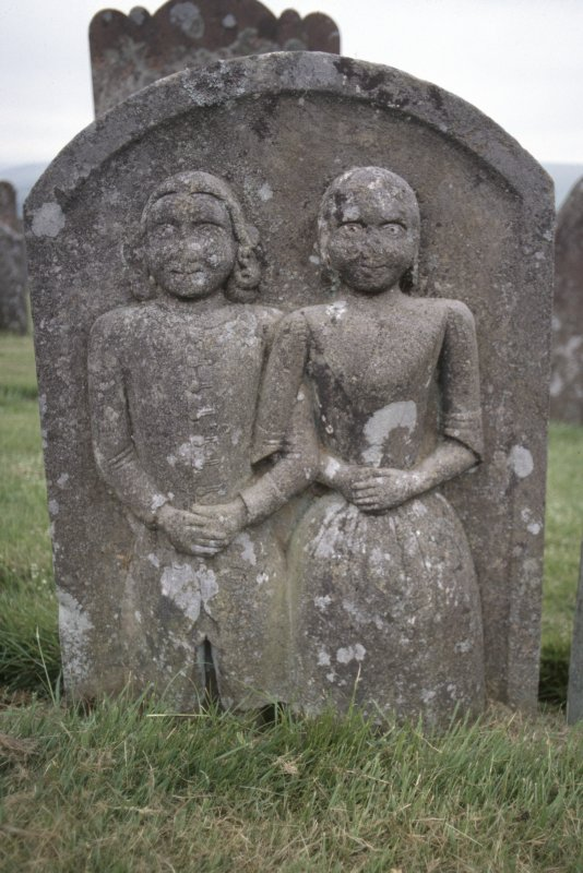 View of headstone  for Dolly Armstrong d. 1763 showing couple with arms linked,  Ettleton Cemetery