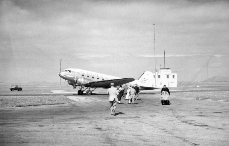 Alistair Maclaren boarding the plane at Benbecula, on the way back from excavations at Drimore.