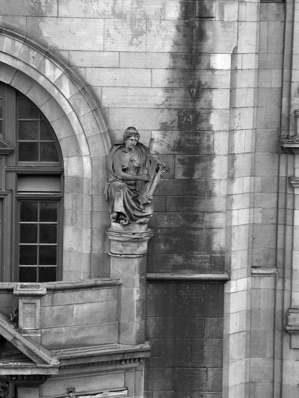 Detail of East facade: showing sculpture (right)