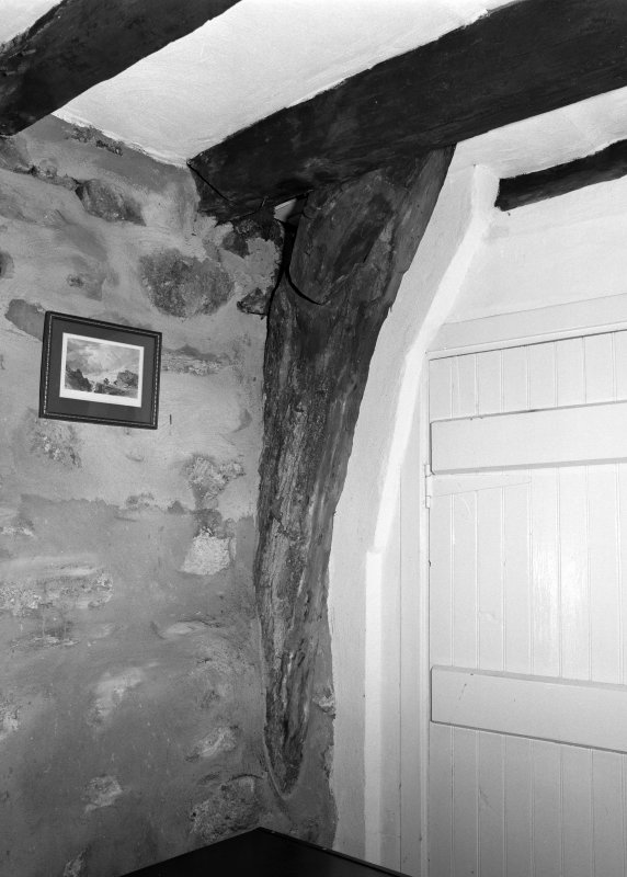 Interior view of cruck-framed cottage showing detail of east cruck in south wall; Wester Auchraw Croft, Lochearnhead.