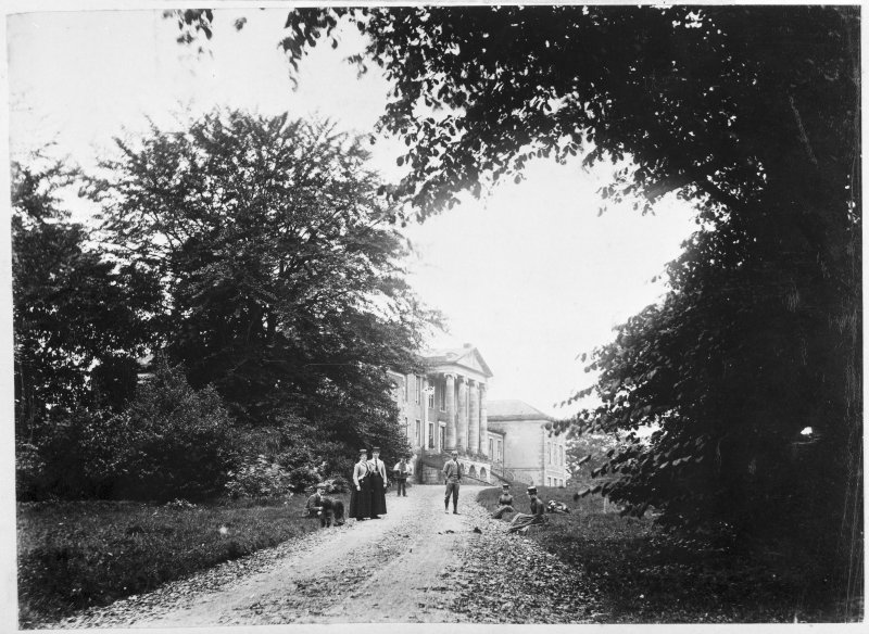 View of the north front of Valleyfield House from the drive to the NE, with figures on and beside the drive.