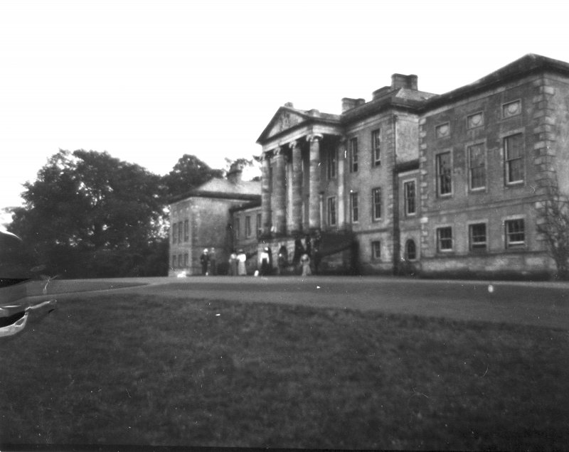 View of the north front Valleyfield House from the NW with a group of figures.