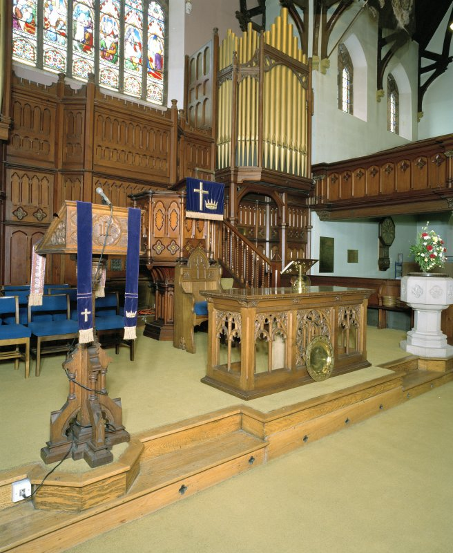 Interior. Platform area with pulpit, lecturn, communion table and organ