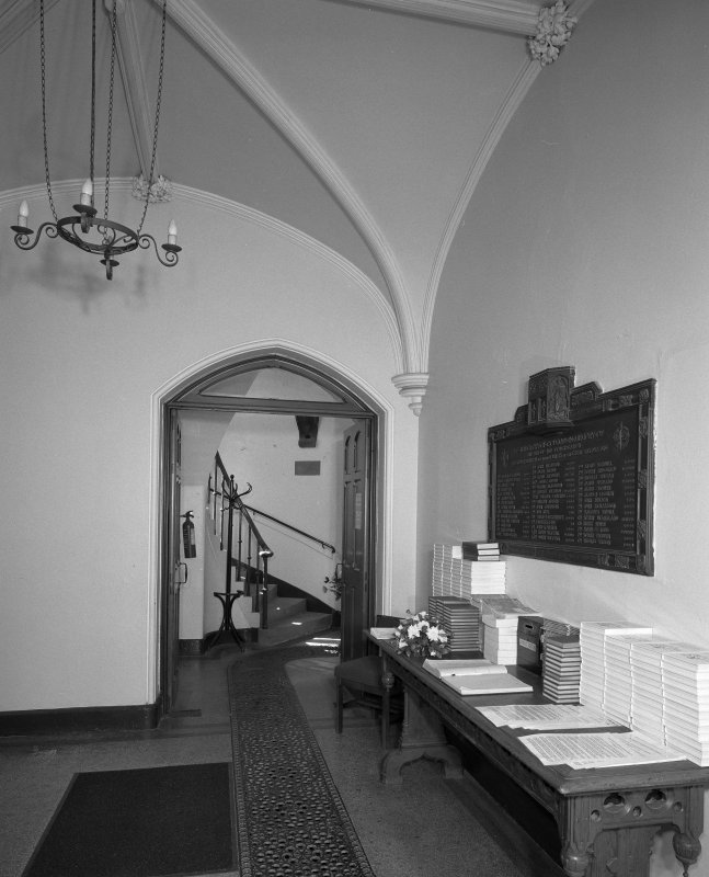 Interior. Front hall with original communion table and War Memorial