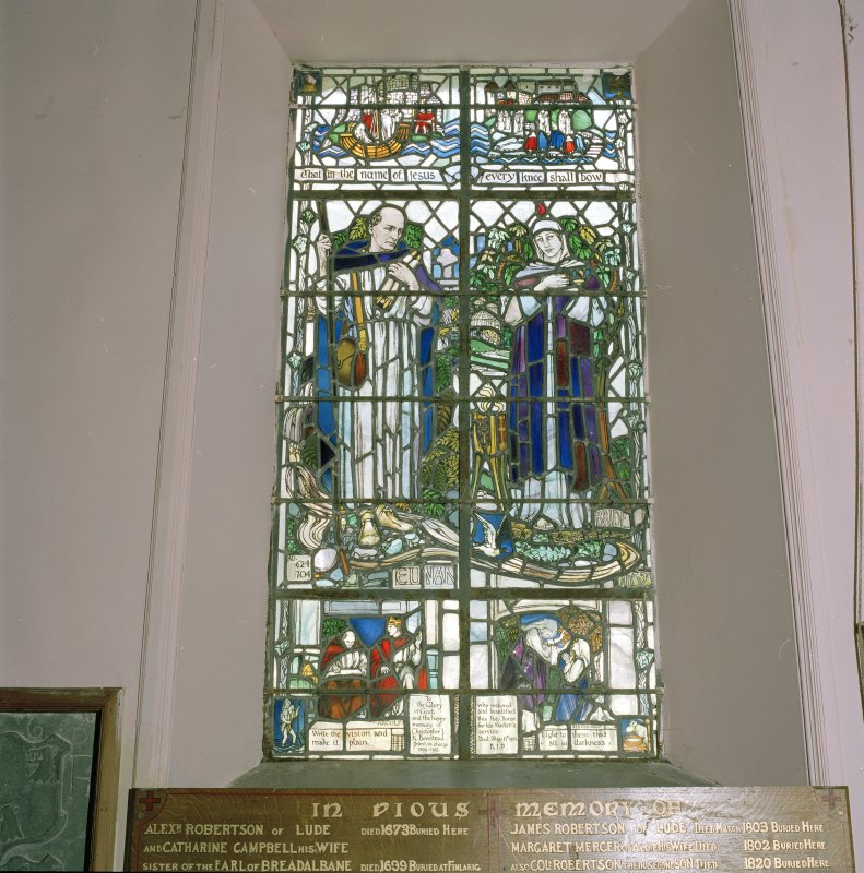 "Interior. Detail of chancel stained glass window depicting SS Euan and Bride "" That in the name of Jesus every knee shall bow"""