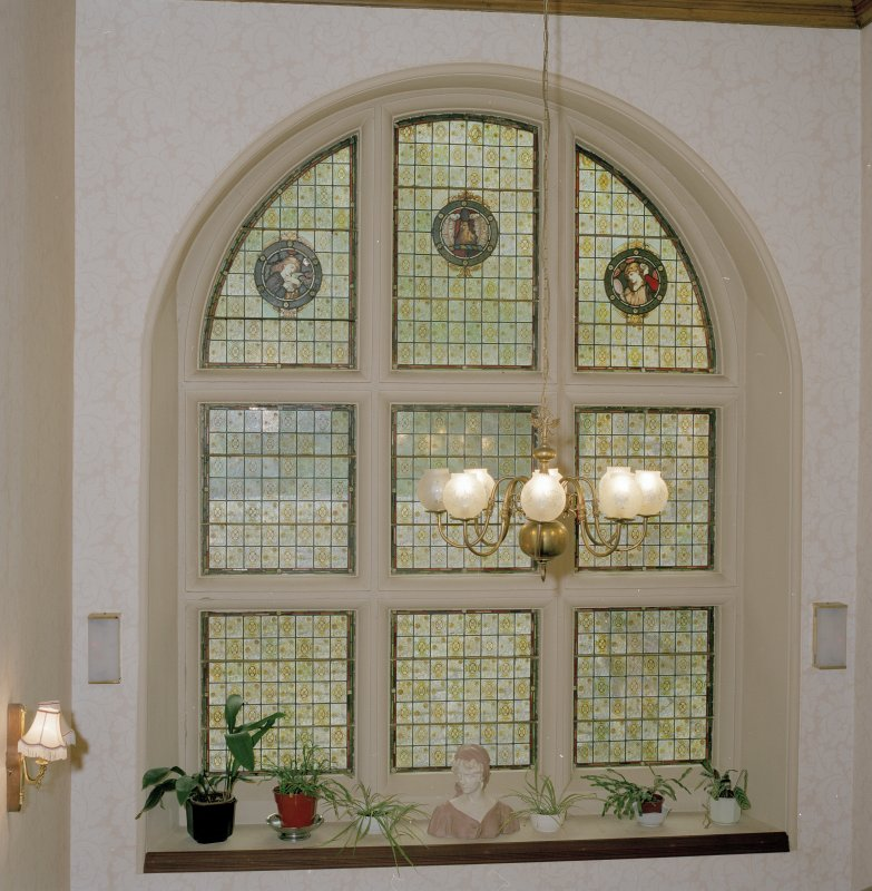 Interior view of Archerfield House. Stair hall stained glass window