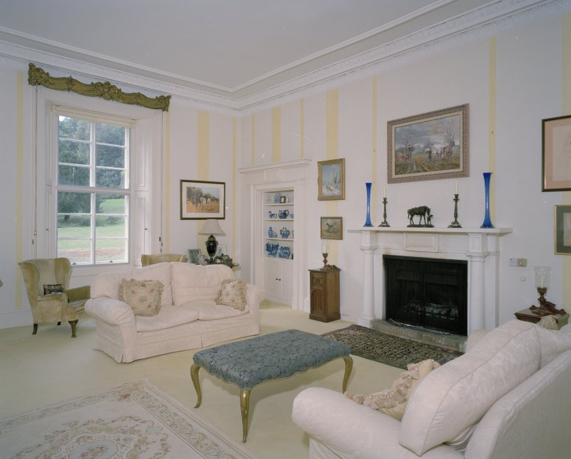 Interior. East wing Drawing room showing early 19th century fireplace and lying pane glazing