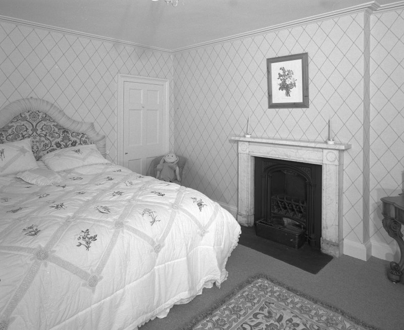 Interior. First Floor central block bedroom with early 19th century marble fireplace