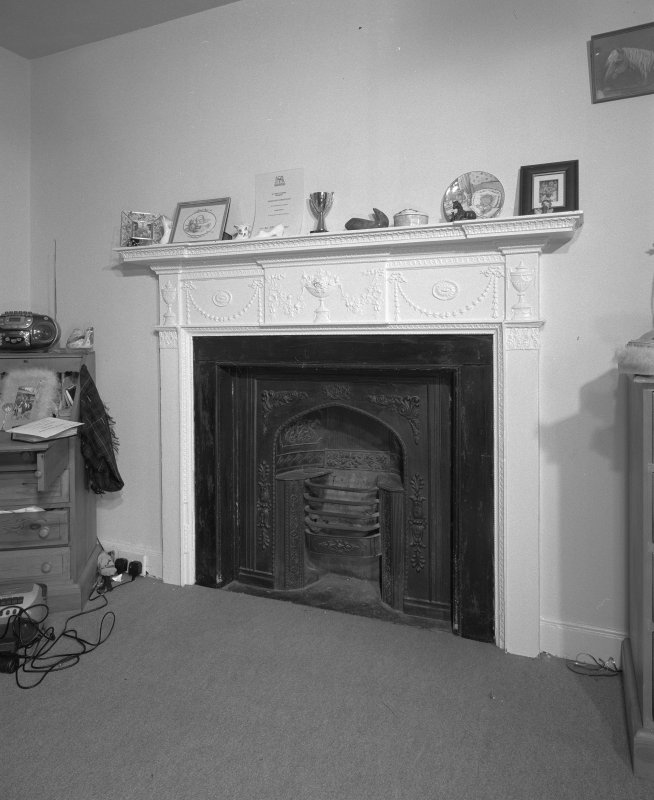 Interior. First Floor central block bedroom composition painted pine fireplace with register grate