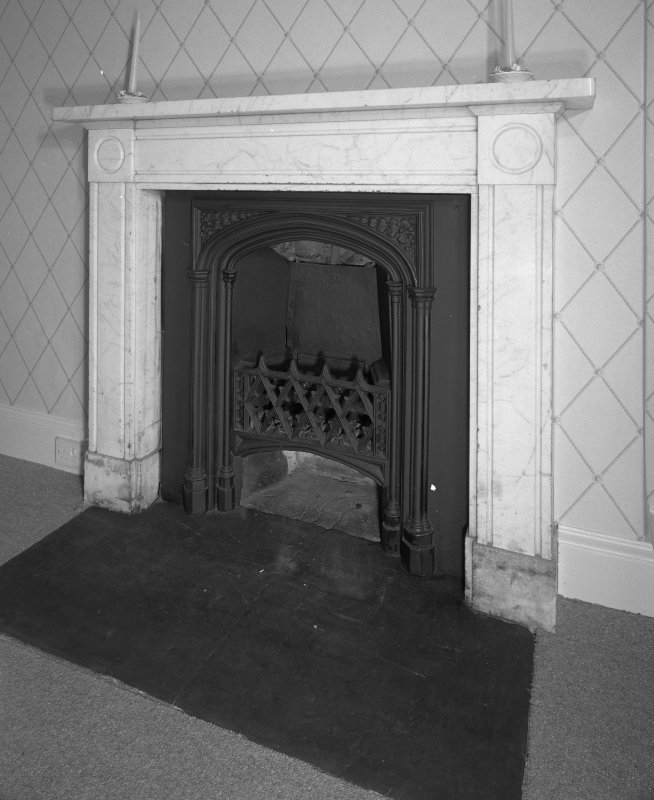 Interior. First Floor central block bedroom fireplace