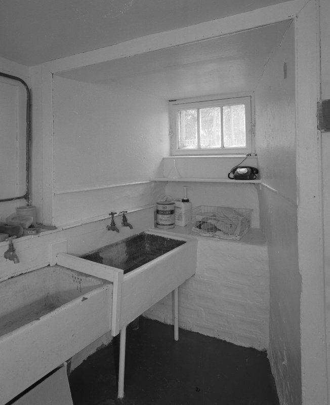 Interior. Basement utility room with belfast sinks