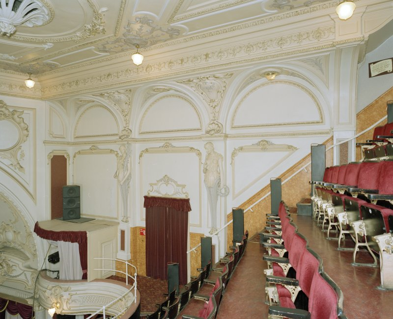 Interior.  Auditorium, Balcony, decorative plasterwork on W wall, view from E