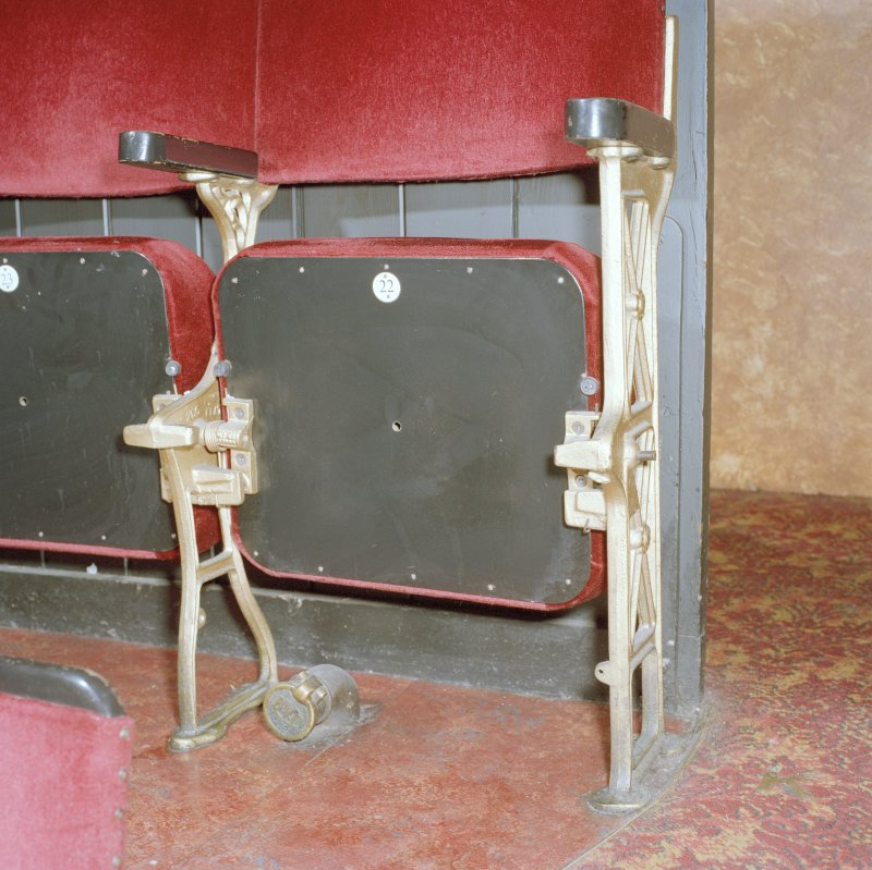 Interior.  Auditorium, Circle, detail of specimen seat with vacuum cleaning connection below