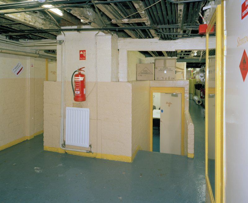 Interior.  Understage area, view from E