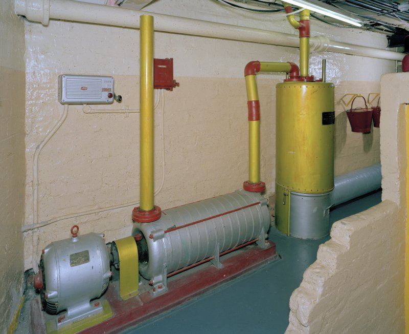 Interior.  Understage area, view of vacuum-cleaning system motor