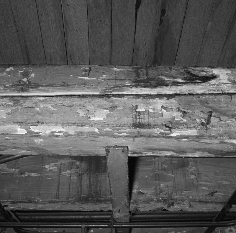 Interior.  Understage area, detail of roof beam showing tracks from stage machinery