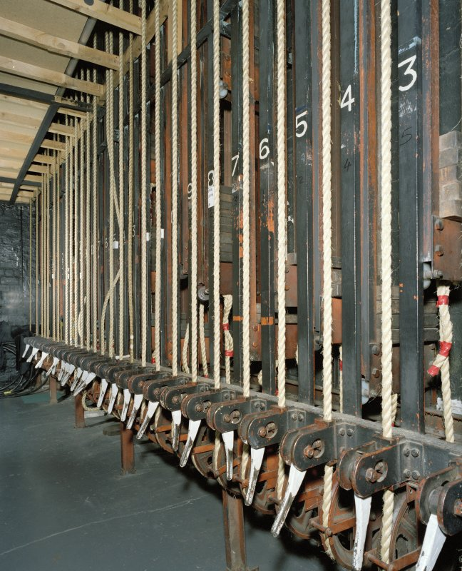 Interior.  Backstage, detail of fly ropes at lower level