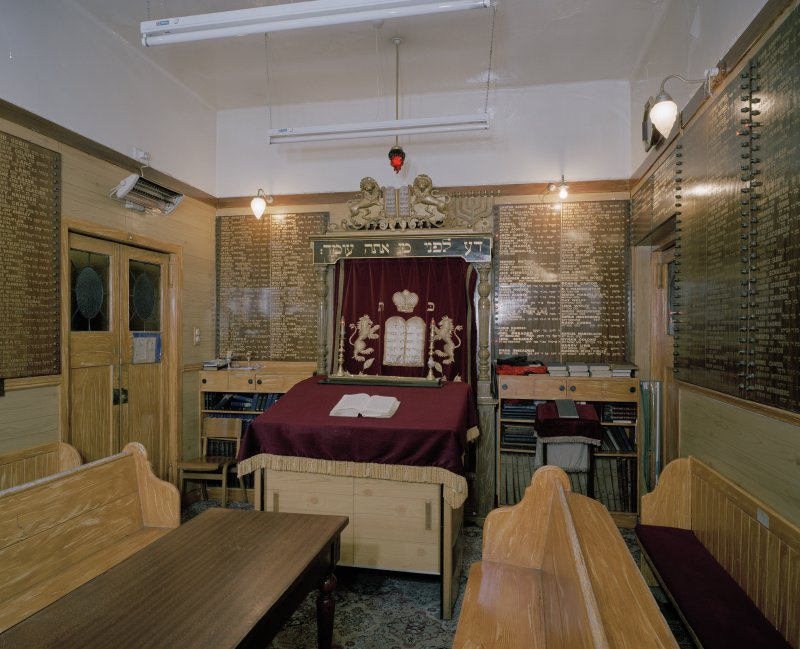 Interior. 'Mini' Synagogue in W corner. Parokhet curtain closed