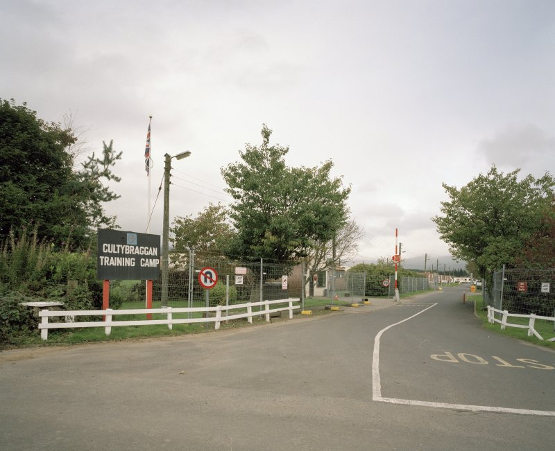View NW showing entrance and barrier with sign