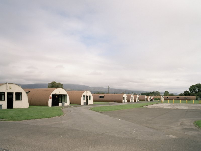 View from SW of R & F accommodation (huts 41-43, 61-5), NAAFI (65)