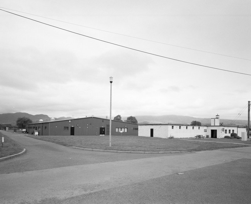 View from SW of main camp store/armoury (hut 19) and central messing building