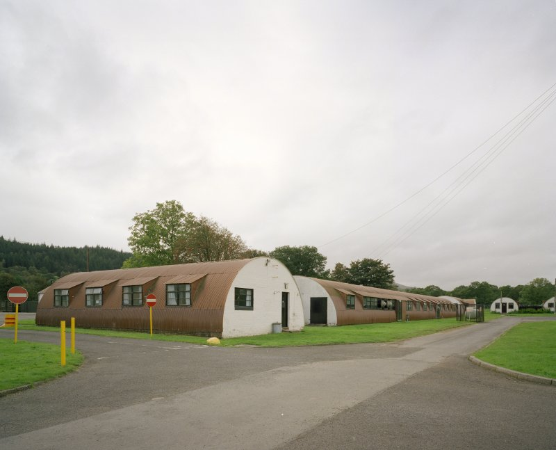 View from E of indoor games room and senior officers accommodation ( huts 15 and 16)