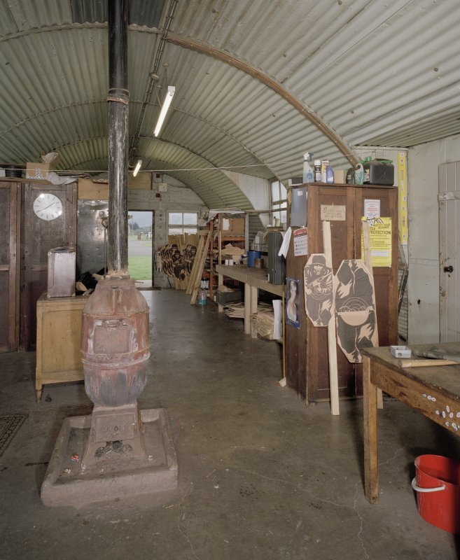 Interior view of workshop / range store (hut 7), showing an original pot bellied stove