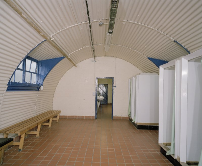 Interior view of officers ablutions (hut 22) showing shower cubicles