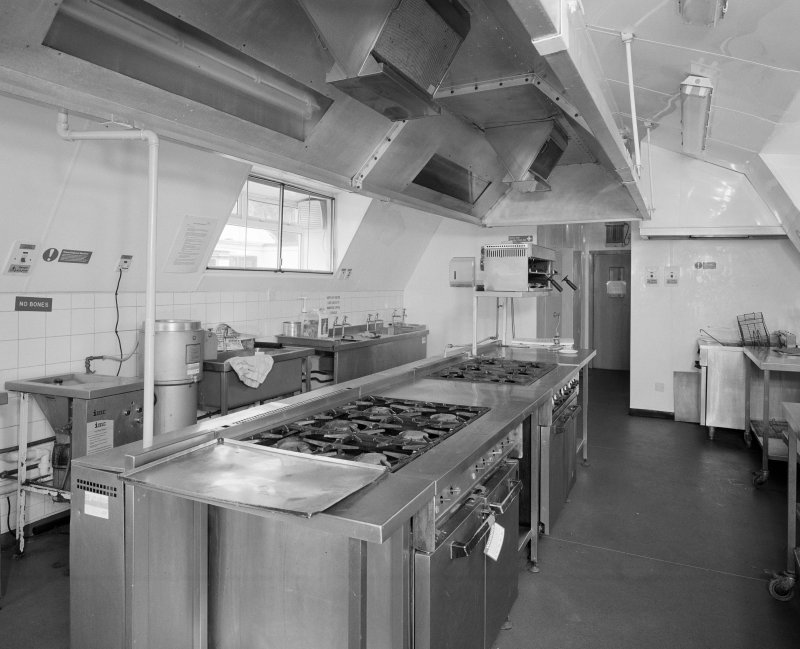 Interior view of sergeants mess, showing kitchen ranges and equipment