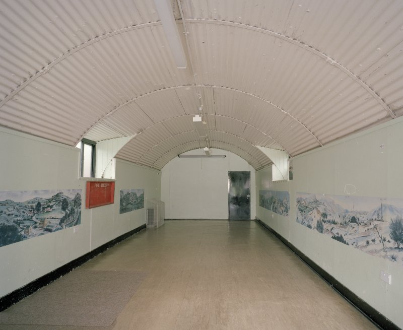 Interior view of lecture room with demonstration scenic dsiplays on the walls