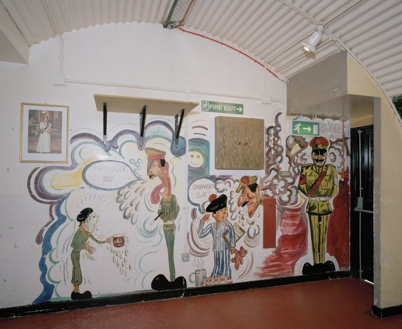 Interior view of NAAF (hut 65)I, detail of wall painting (cartoon) near entrance