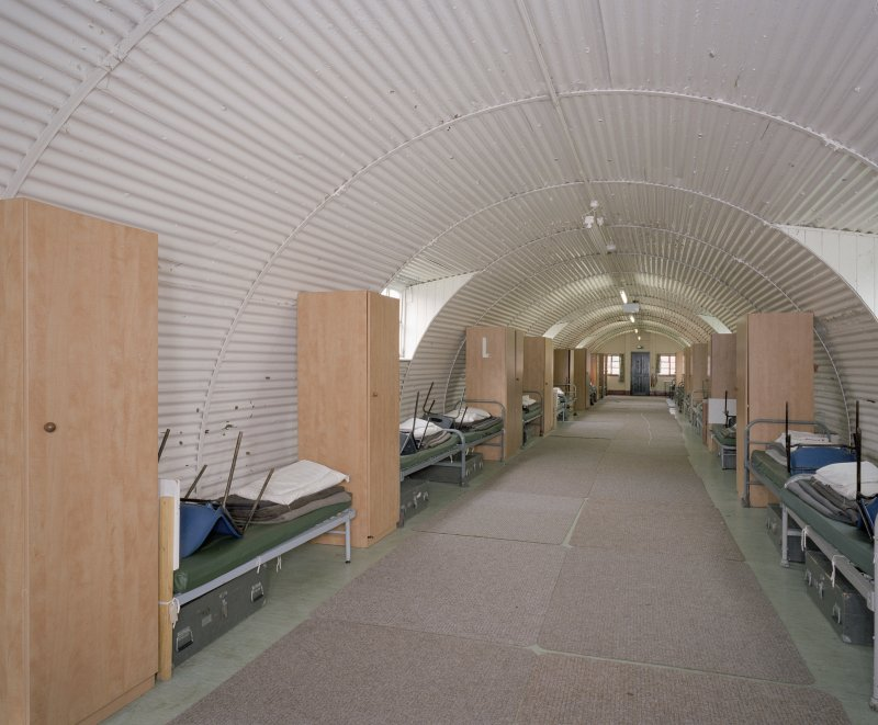 Interior view of R & F accommodation hut (hut 63) showing beds and wardrobes