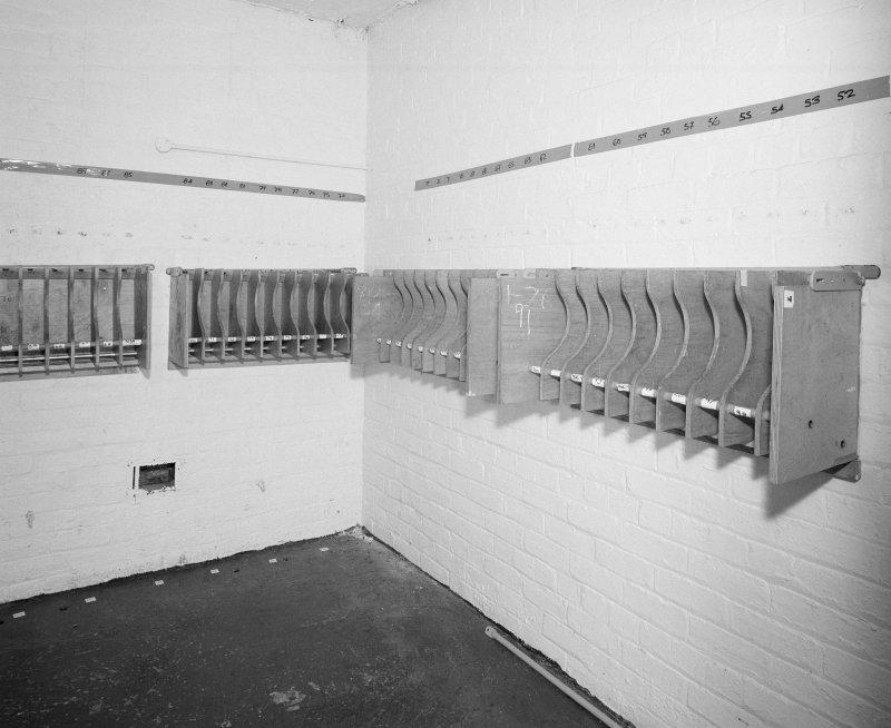 Interior view of armoury/main camp store, showing former cell