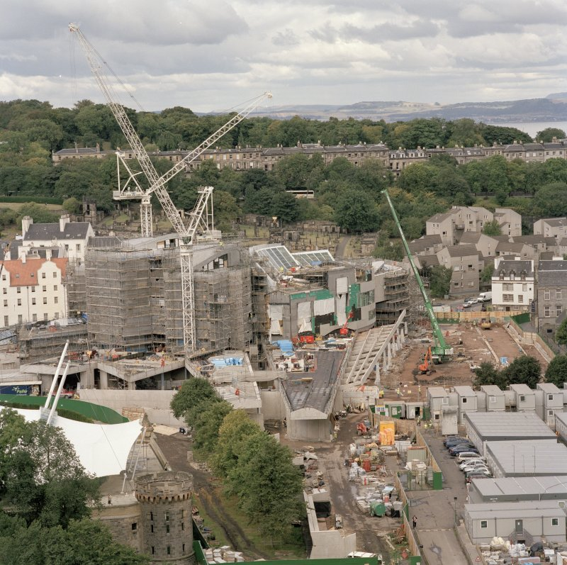 View from Salisbury Crags to south showing Parliament building under construction.
