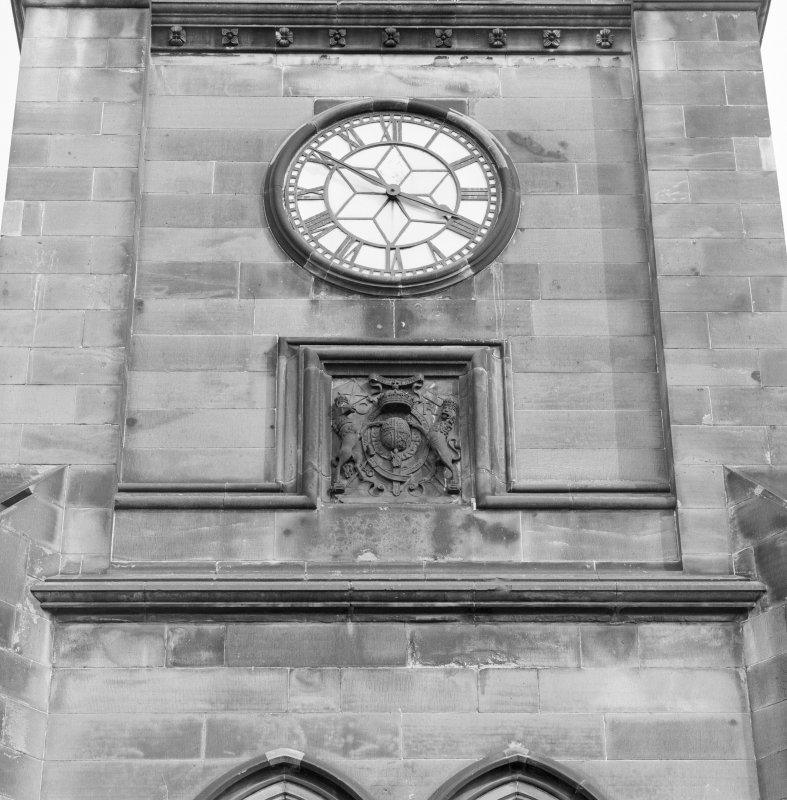 Tower, detail of clock and armorial panel below