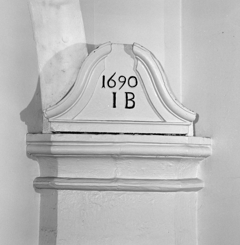 Interior, south east vestibule, detail of corner respond with 1690 datestone