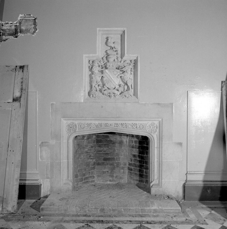 Interior. Ground floor, entrance hall, view of fireplace with coat of arms above