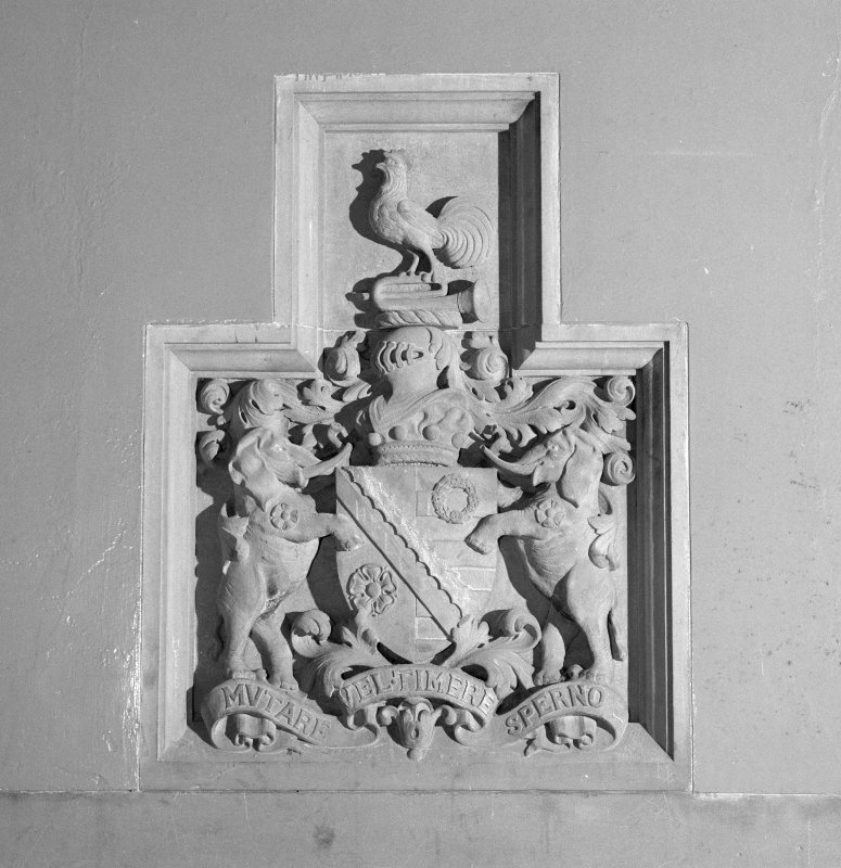 Interior. Ground floor, entrance hall, detail of coat of arms above fireplace
