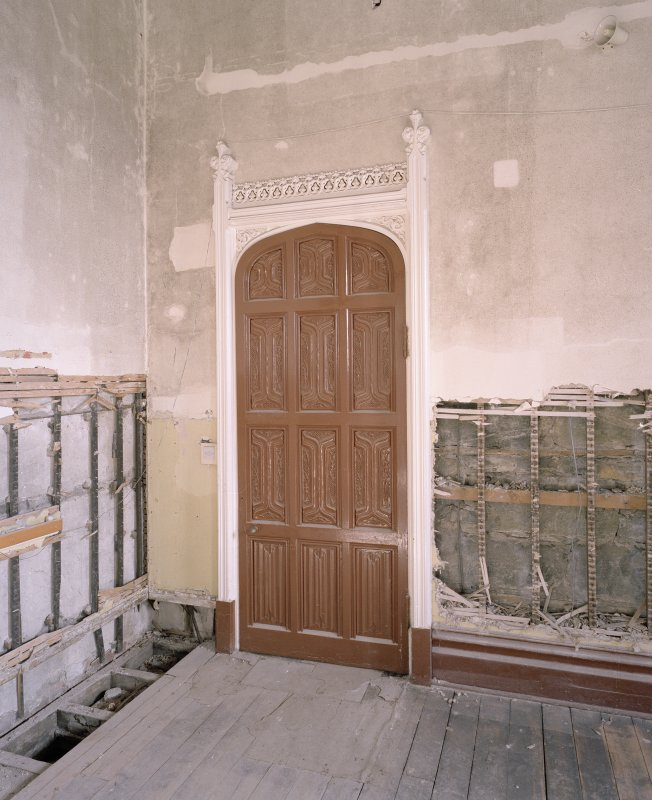 Interior. Ground floor, dining room, view of NE door and surround