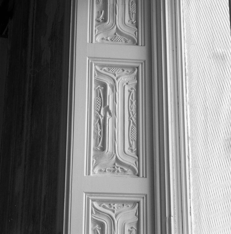 Interior. Ground floor, dining room, detail of carved panel on window shutter